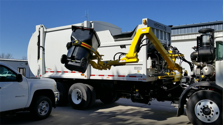 Drivers getting familiar with automated garbage equipment