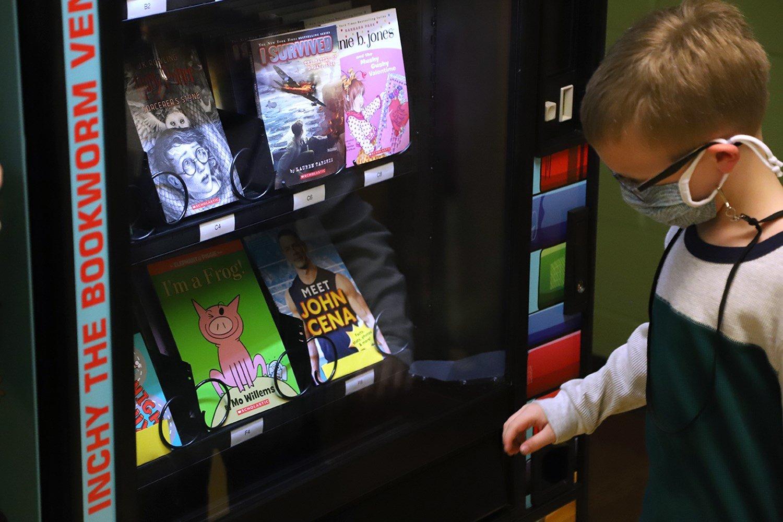 Elementary school PTO helps fill book vending machine