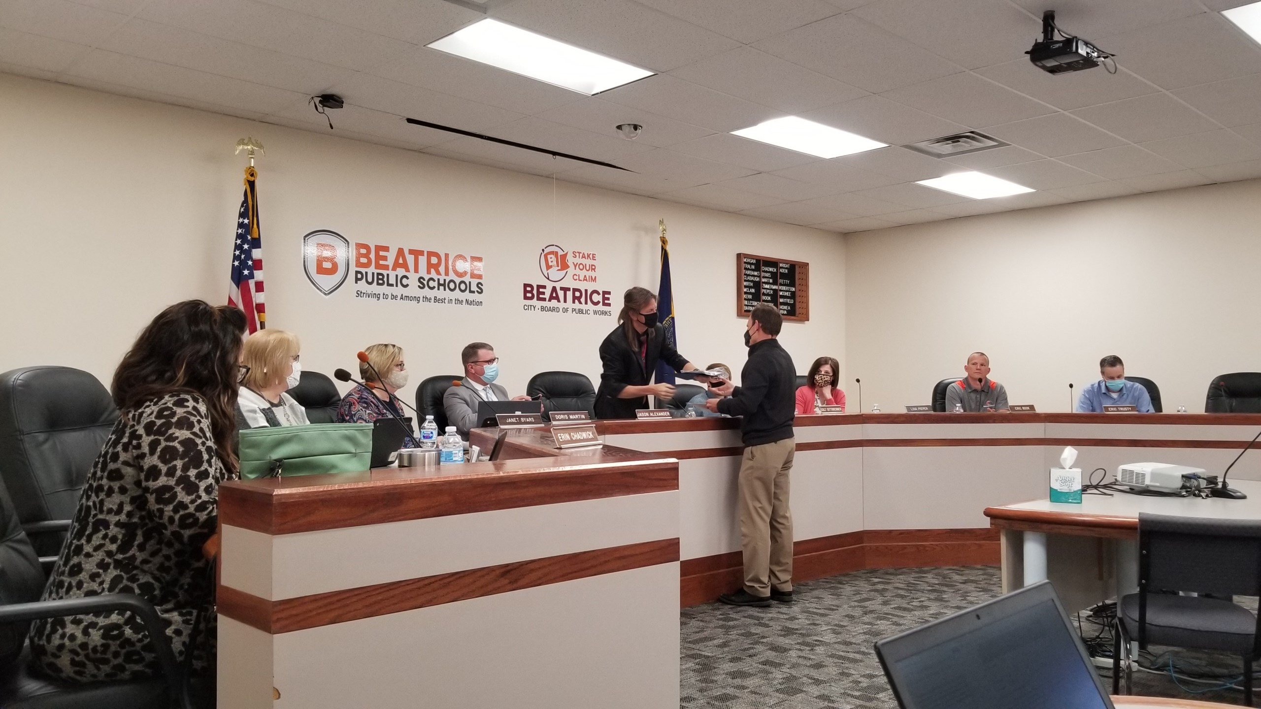 Retiring A.D., business friend and student athletes, honored by Beatrice School Board