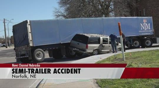 No one injured in Norfolk crash involving semi and SUV