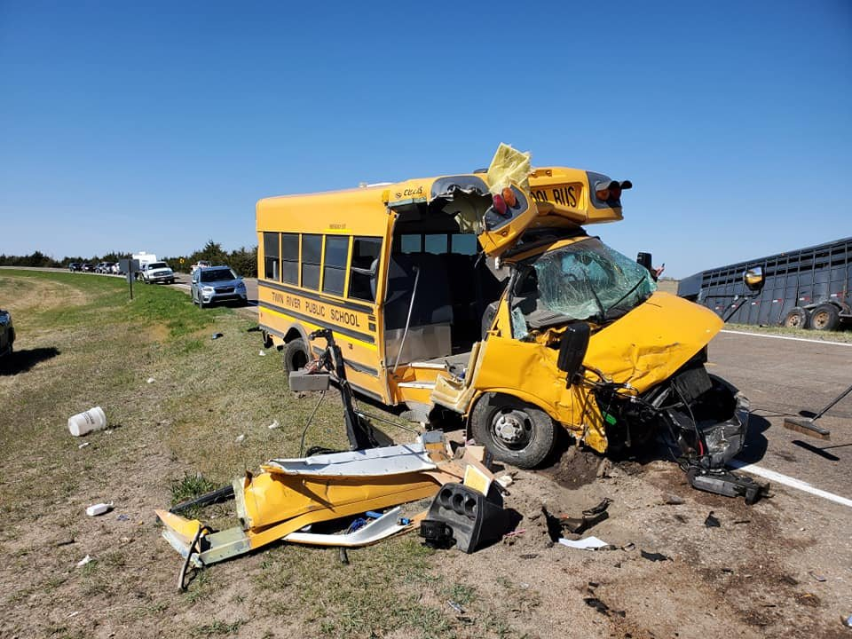 No serious injuries in crash involving school bus, truck hauling livestock