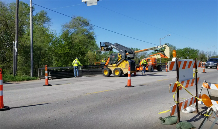 Beatrice West Court river bridge being fitted with new pedestrian rails