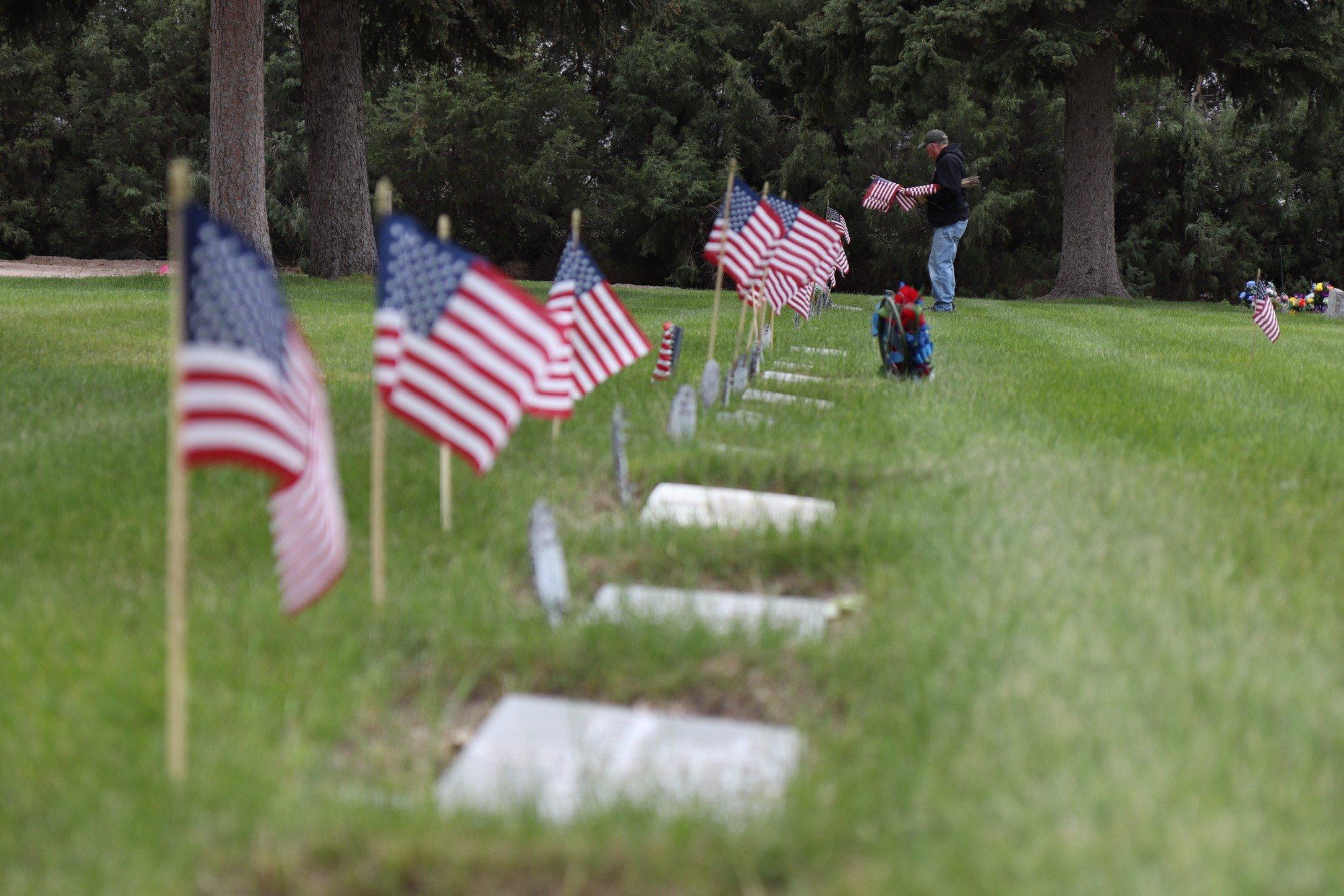 PHOTOS: Volunteers prep Greenwood Cemetery for Memorial Day