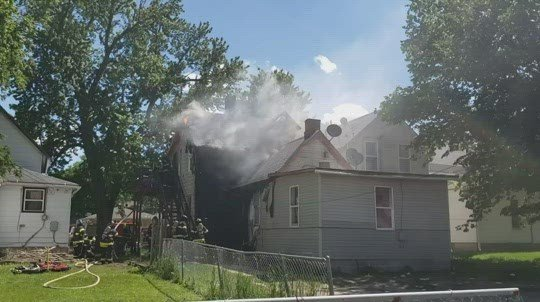 Four people, two dogs escape house fire