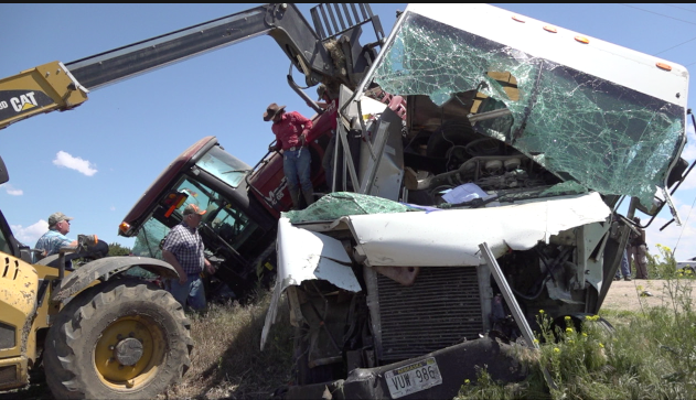Two injured after farm vehicle, freight truck collide
