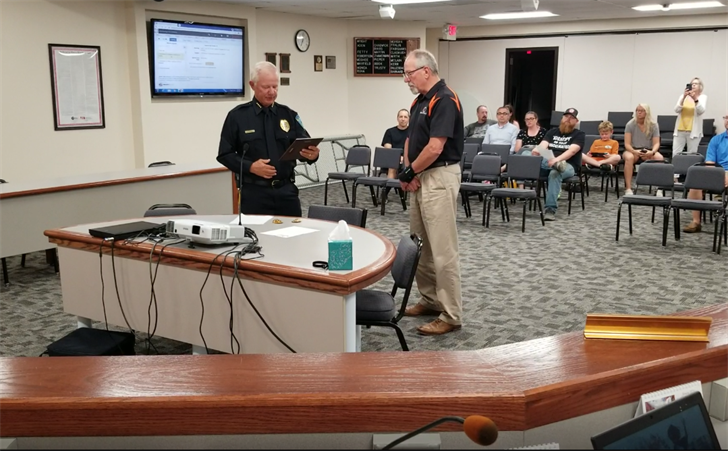 Retiring Beatrice Police Captain honored….two officers promoted