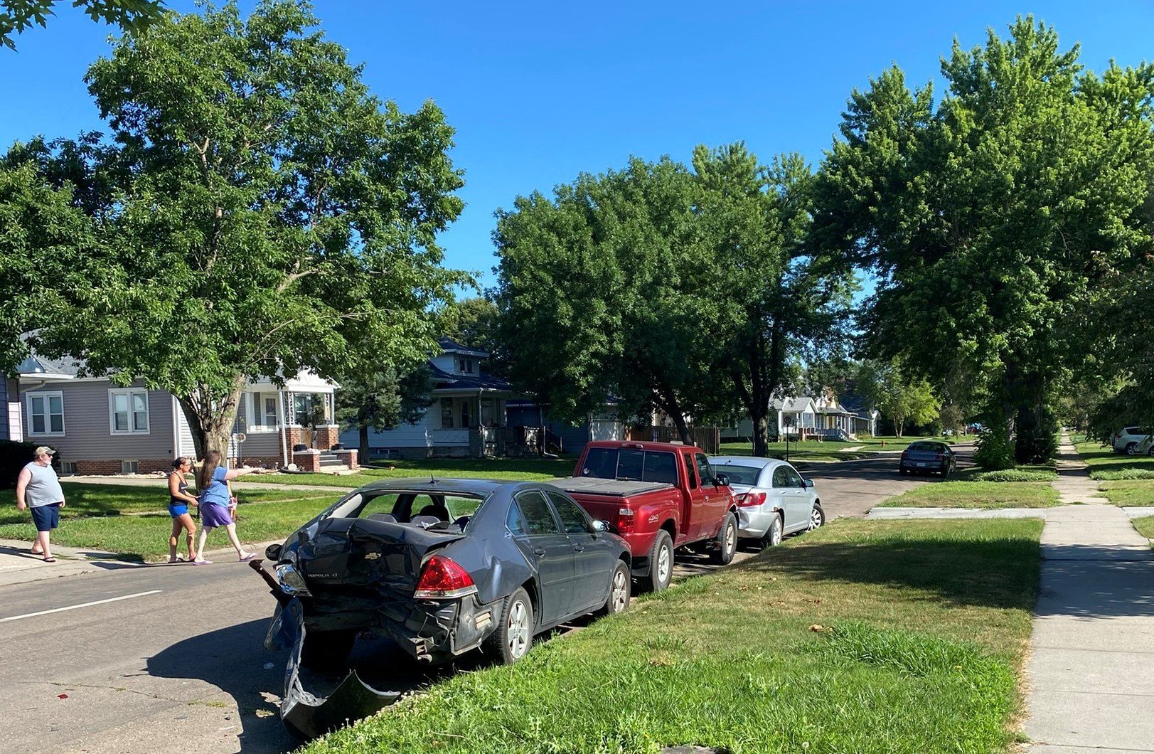 Multiple parked cars damaged in Tuesday morning accident