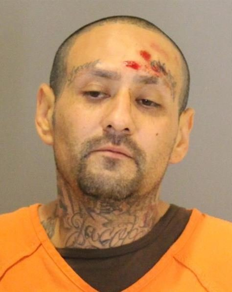 OPD: Man armed with shotgun, later charges officer