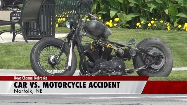 One person hospitalized after car strikes motorcycle