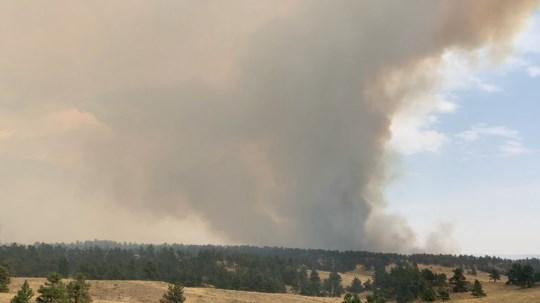 Hackberry Fire Update: High winds help blaze spread, more help inbound