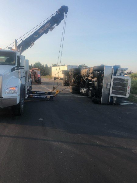 Truck misses curve, overturns south of Cortland