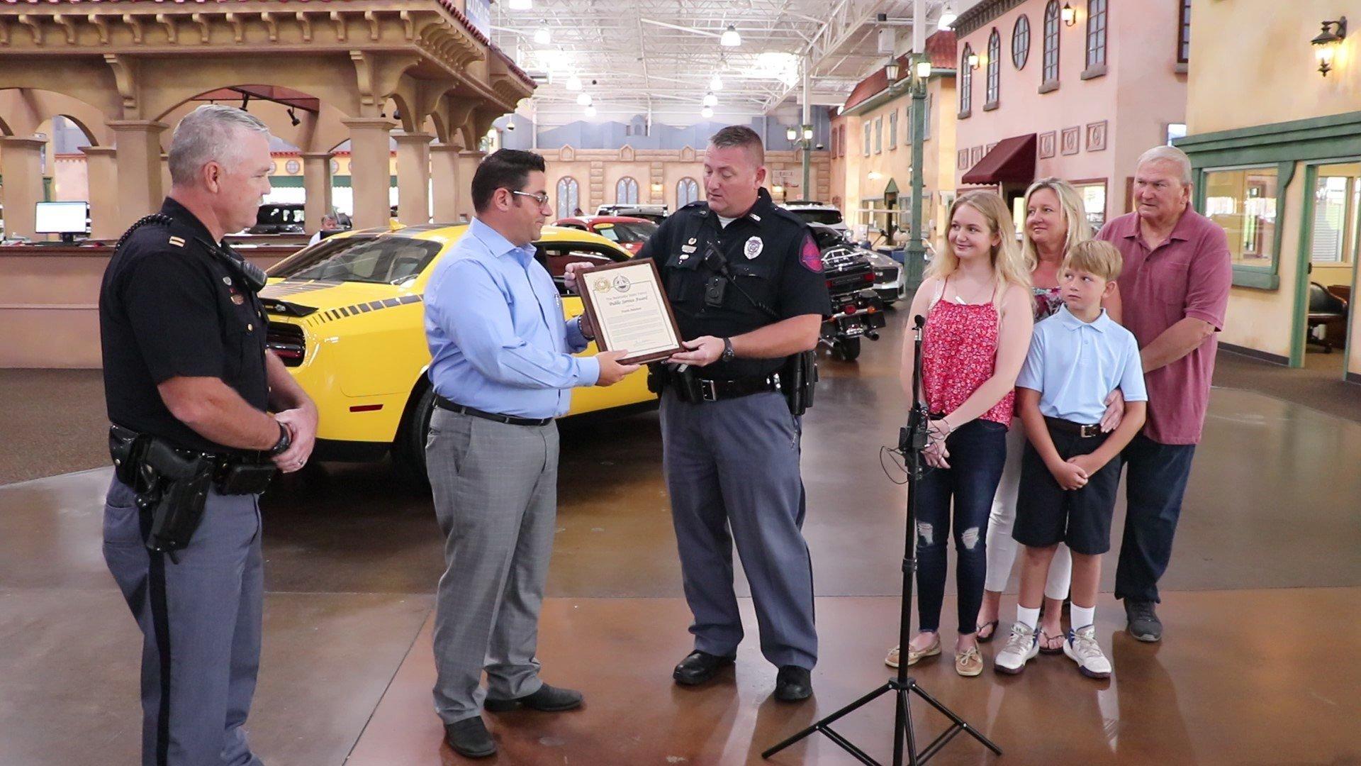 Omaha man presented award for saving two from burning vehicle